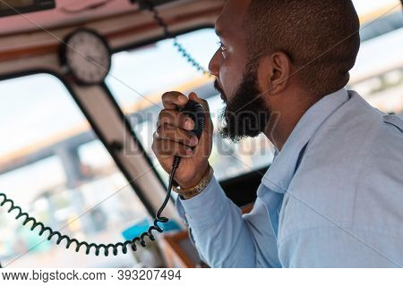 Navigation Officer / Pilot On The Bridge Of A Moving Ship With A Radio Station