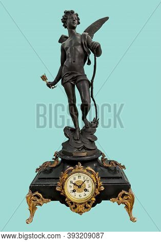 Antique Mantel Clock With Eros Statuette In Basalt Black Holding Bow And Arrow, On Isolated Green Ba