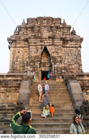 Magelang, Indonesia. July 21, 2017: Mendut Temple In The Morning. Some Tourists Climb The Temple