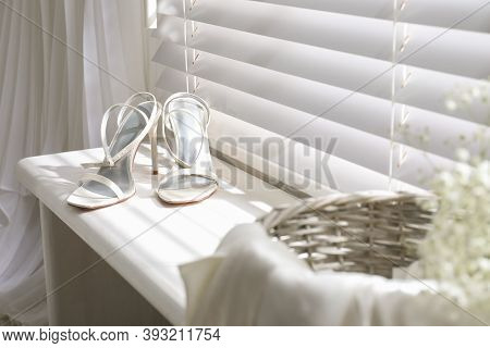 Beautiful Wedding Shoes On Window Sill Indoors