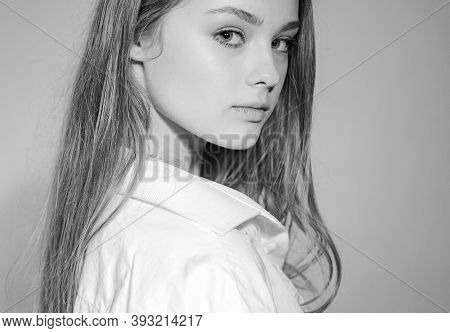 Headshot Portrait Of Beauty Girl With Beauty Face Looking At Camera. Close Up Portrait Of Young Chee