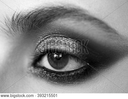 Smokey Eyes Makeup Close Up Photo. Professional Smokey Eyes Make Up At Beautiful Girl For Special Oc