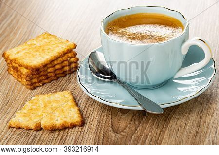 Stacks Of Crunchy Cookies With Sesame, Broken Cracker, Coffee Espresso In Light-blue Cup, Spoon On S
