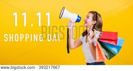 Portrait Asian Beautiful Happy Young Woman Smiling Hold Shopping Bags Multi-color And Shouting In Me
