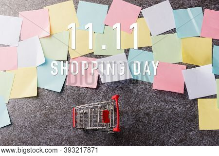 Above Blank Paper Stick Note List Yellow And Green With The Shopping Cart With 11.11 Single's Day Te