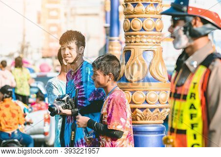 Kanchanaburi, Thailand - April 17,2019: Unidentified Young Photographer In Wet Clothes Use Dslr Came