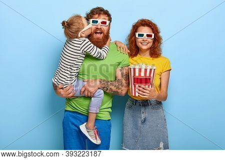 Family Portrait Of Three Redhead Members Wears 3d Glasses And Eat Popcorn, Being In Cinema, Come On