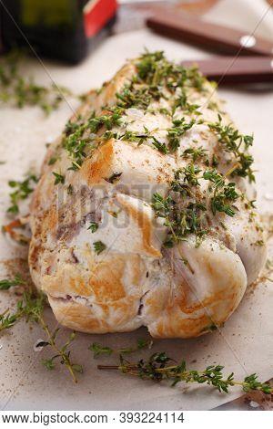 Raw turkey breast roll with herbs prepared to roasting