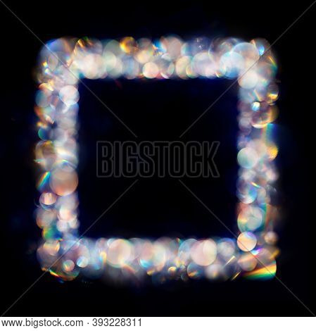 Iridescent Neon Colored Multiple Bokeh Spots In Square Frame.