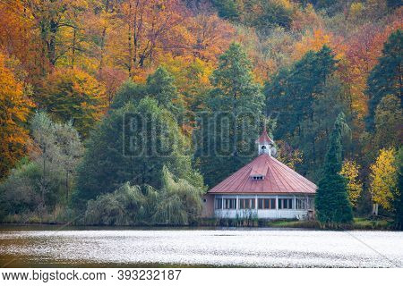 Small lake of Mogasa in Transylvanian mountains in magic autumn colors.