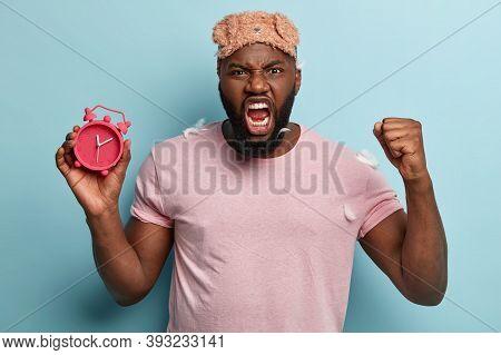 Angry Dark Skinned Guy Raises Fist With With Irritation, Being Very Emotional, Annoyed Of Awakening