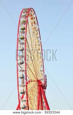 colored Ferris wheel against the blue sky poster