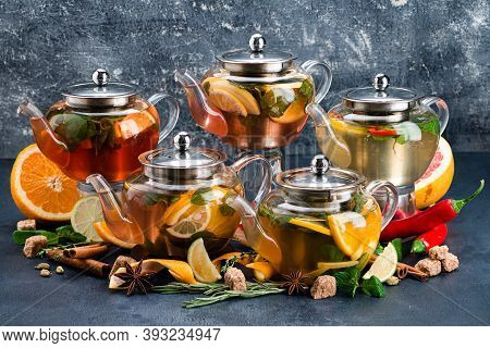 Teapots Collection. Brewing Teapot Set Colorful Brewing Teapots In Row, Five Brewed Teas In Teapots
