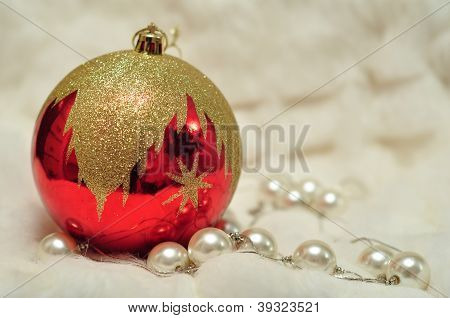 Christmas Decoration: Red Bead, Pearls On White Blured Background