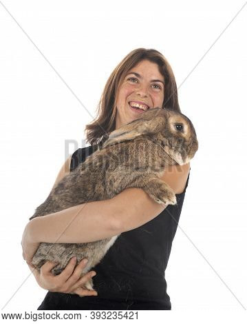 Flemish Giant Rabbit And Woman In Front Of White Background