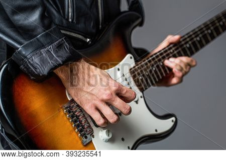 Man Playing Guitar. Close Up Hand Playing Guitar. Musician Playing Guitar, Live Music. Electric Guit