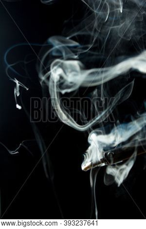 Heated Soldering Iron With Smoke From The Sting Of Burning Rosin. Photo On A Black Background