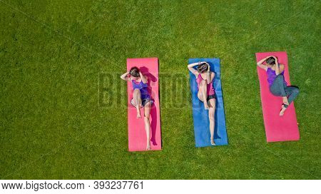 Family Fitness And Sport Outdoors, Group Of Active Girls Doing Workout In Park, Aerial Top View From