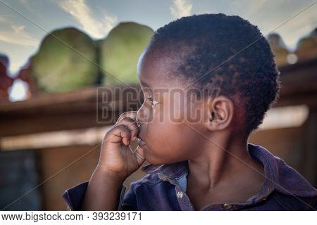 african girl street vendor with entrepreneurial spirit, selling vegetables on a wooden table