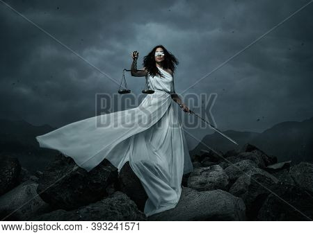 Young Fairly Woman With Scale And Sword Over Dramatic Sky With Copy Space