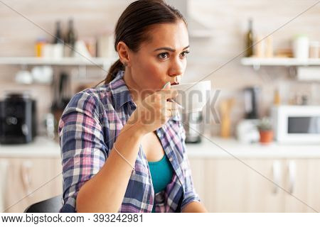 Lady Relaxing And Sipping Hot Green Tea From Porcelain Cup During Breakfast In Pretty Lady Sitting I
