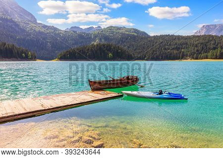 Lonely Boats In The Black Lake On Mount Durmitor, Montenegro