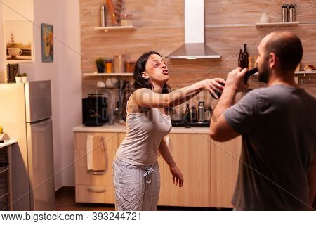 Wife Victim Of Domestic Violence Fighting Abusive And Alcoholic Husband While Hes Drinking. Traumati