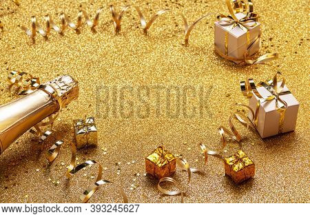 Happy New Year 2021 And Merry Christmas. New Year Gifts And Tinsel On Golden Background