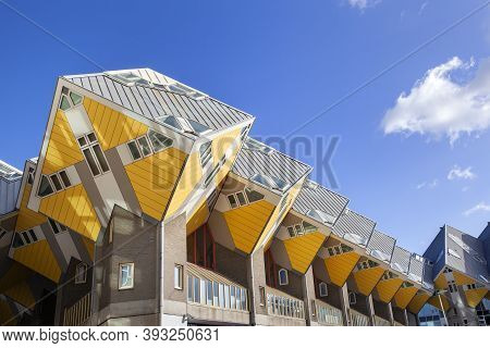 Rotterdam, Netherlands - November 4, 2020: Yellow Cubic Houses Or Kubuswoningen By Architect Piet Bl