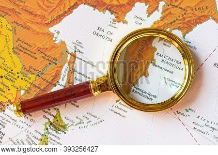 Lviv/ukraine-09 21 2020 : Kamchatka Peninsula Russia On A Map Of Eurasia  In A Defocused Magnifying