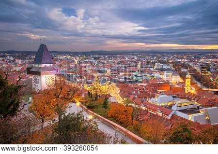 Graz, Austria. Cityscape Image Of The Graz, Austria With The Clock Tower At Beautiful Autumn Sunset.