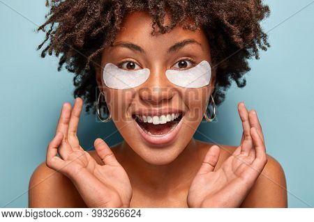 Headshot Of Ovejoyed Beautiful Woman Reduces Under Eye Puffiness, Dark Circles, Applies Moisturizing