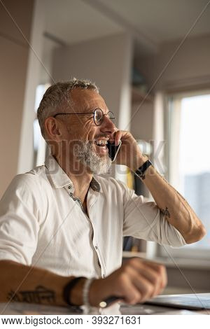 Laughing Businessperson Is Having A Phone Conversation