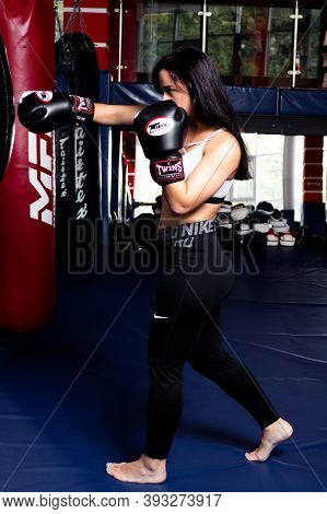 Khabarovsk, Russia - Jul 29, 2017: Girl Boxer Practicing Punches On A Punching Bag