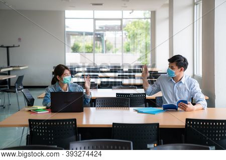 Two Asian University Student With Face Mask Back At School Meeting And Greeting Friend By Say Hi To