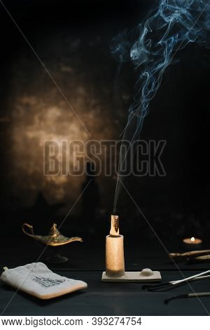 Palo Santo Stick On Fire With Smoke In A Beautiful Candlestick. Composition Of Esoteric Objects Used