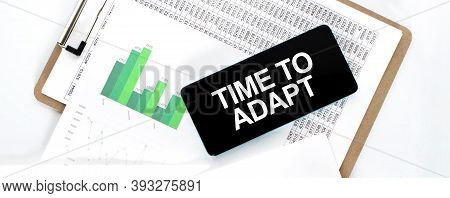 Paper Plate With Financial Amounts, Green Diagram And Phone On The White Desk. Business Concept. Tim