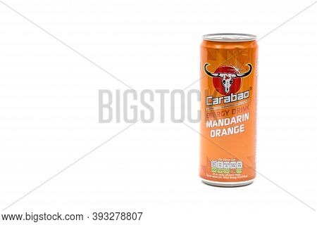 London, United Kingdom, 14th October 2020:- A Can Of Carabao Mandarin Energy Drink Isolated On A Whi