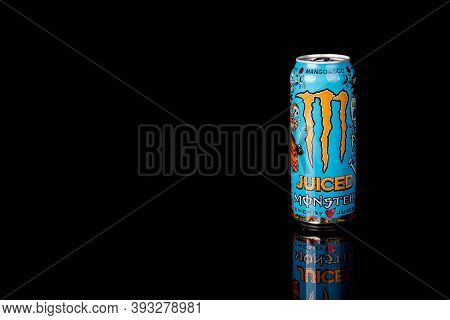 London, United Kingdom, 14th October 2020:- A Can Of Monster Mango Loco Energy Drink Isolated On A B