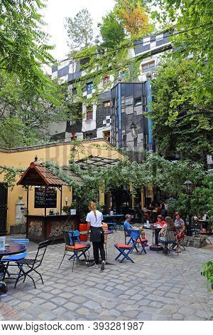 Vienna, Austria - July 12, 2015: People At Kunst Haus Cafe Famous Building By Architect Hundertwasse