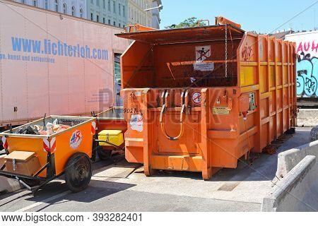 Vienna, Austria - July 11, 2015: Press Container Compactor Big Industrial Waste Disposal Hydraulic B
