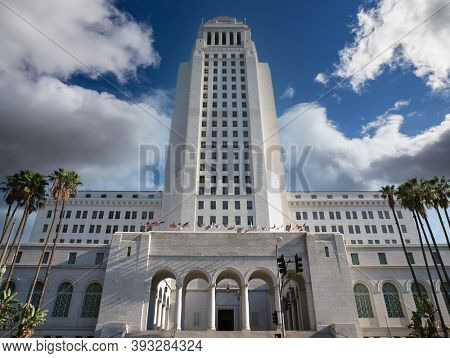 Los Angeles City Hall Spring Street entrance with cloudy sky.