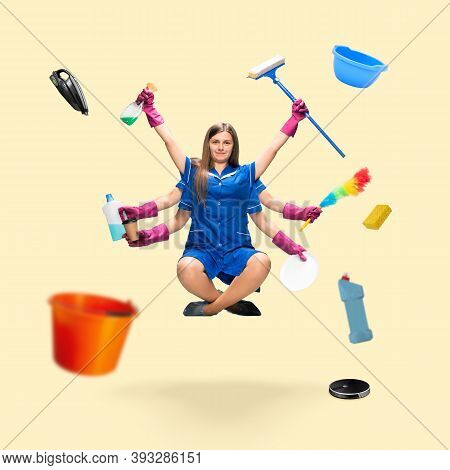 Handsome Maid, Multi-armed Housemaid Levitating Isolated On Yellow Studio Background With Equipment.