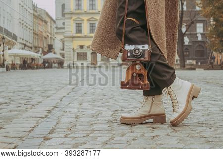Faceless Image Of Young Stylish Woman - Travel Blogger Walking Down The Central City Street Using Ol