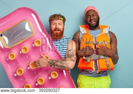 Discontent Dejected Multiethnic Friends Dissatisfied With Something, Pose With Swimming Equipment, C