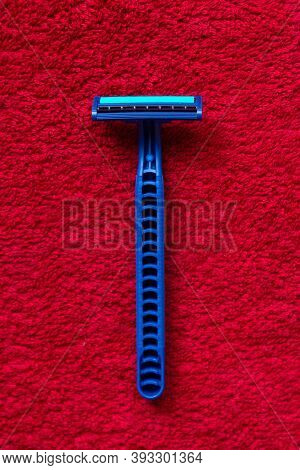 The Blue Razor Lies On The Red Cloth. Deep Texture.