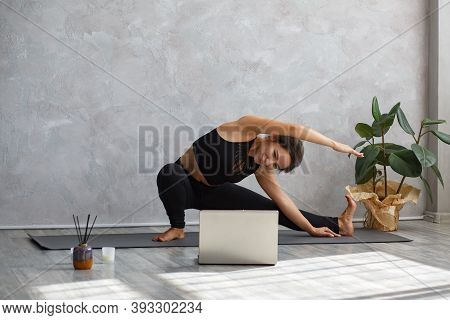 Young Sporty Female Yoga Instructor Coaching Online, Making Video Of Yoga Lessons On Laptop Camera.
