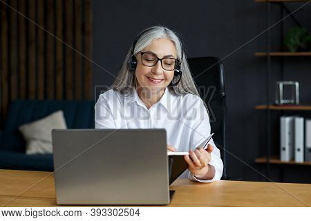 Portrait Of Beautiful Smiling Elderly Woman Studying Online. Online Education, Remote Working, Home