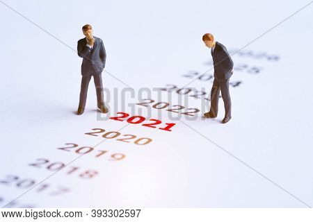 Year Red 2021 And Businessman Standing On Paper White Background. Concept For Business Vision And Bu
