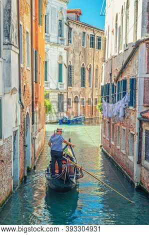 Venice, Italy, September 13, 2019: Gondola Sailing Narrow Canal Between Old Buildings With Brick Wal